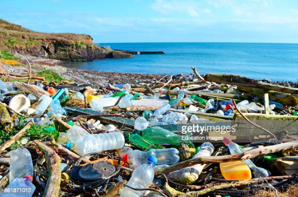 plastic bottles and other garbage washed up on a beach in the county of cork Ireland
