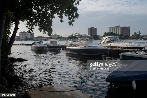 Plastic bottles are seen floating between motorboats in the Lagos Lagoon in Lagos on June 2 2018 On June 5 2018 the United Nations mark the World...