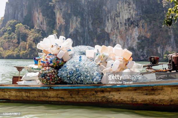 plastic bottles collected for recycling at railay beach, krabi, thailand - プラスチック汚染 ストックフォトと画像