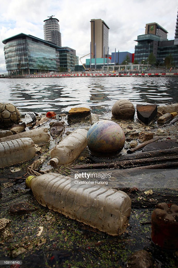 Plastic bottles, footballs and floating rubbish pollutes Manchester Ship Canal at Salford Quays on July 27, 2010 in Salford, England.