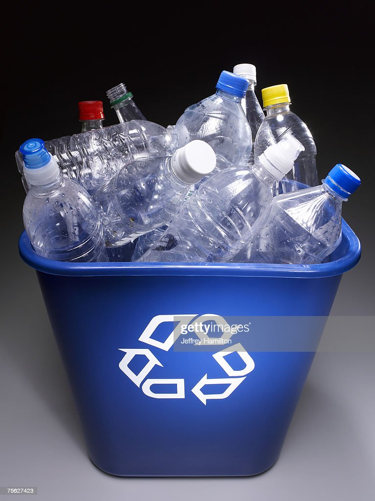 Plastic bottles in trash bin with recycle sign, elevated view : Stock Photo