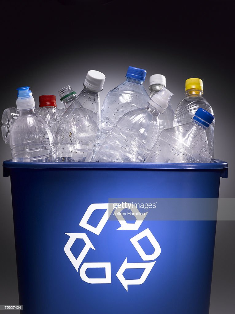Plastic bottles in trash bin with recycle sign : Stock Photo