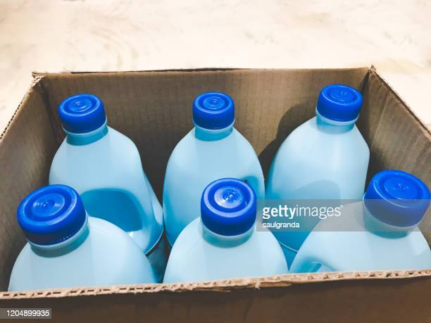 plastic bottles inside a cardboard box - clorox bleach stock pictures, royalty-free photos & images