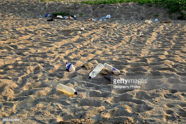 Plastic bottles litter on sandy beach Pasikudah Bay Eastern Province Sri Lanka Asia
