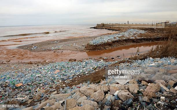 Plastic bottles litter the Ghadir river bed as it pours into the Mediterranean Sea on January 14 2017 near Beirut's International Airport / AFP /...