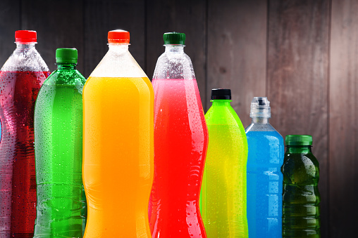 Plastic bottles of assorted carbonated soft drinks 945120950
