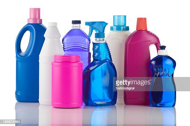 plastic bottles of chemical cleaning products on white backdrop - dishwashing liquid stock photos and pictures