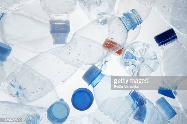 plastic bottles - plastic stock pictures, royalty-free photos & images