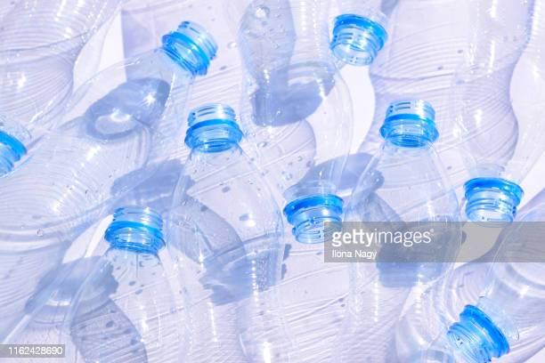 plastic bottles - plastikmaterial stock-fotos und bilder