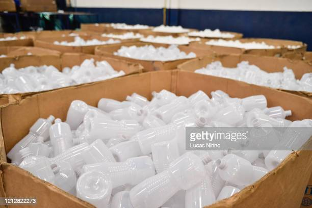 plastic bottles stored inside cardboard boxes - industrial storage bins stock pictures, royalty-free photos & images