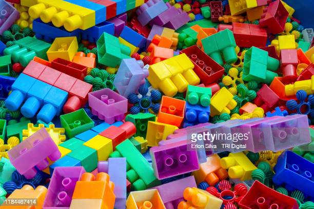 plastic building blocks for colorful background - model kit stock pictures, royalty-free photos & images