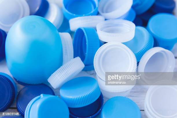 plastic caps - disposable stock photos and pictures