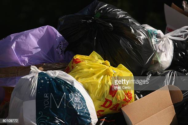 Plastic carrier bags and other rubbish overflow from a pair of wheelie bins in Bath on March 4 2008 in Somerset United Kingdom The Prime Minister...