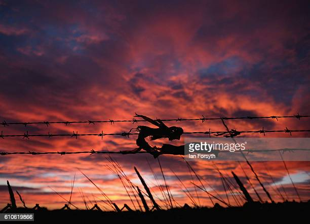 Plastic caught on a fence blows in the morning breeze under a dramatic dawn sky on September 27 2016 in Redcar United Kingdom One year on since the...