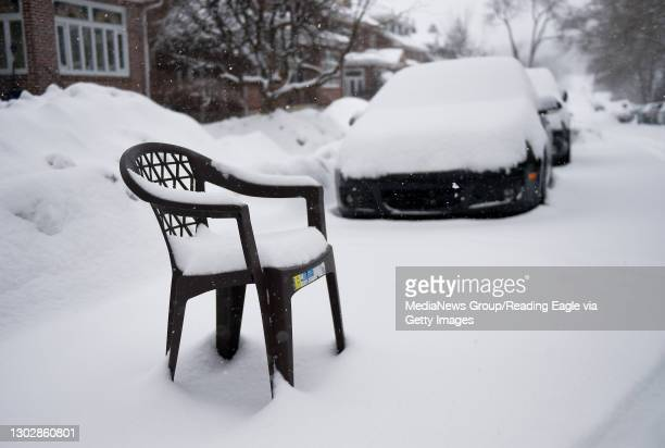 Plastic chair placed in a parking spot to save it in the 1700 block of Olive Street in Reading. During a snow storm in Reading, PA Thursday morning...