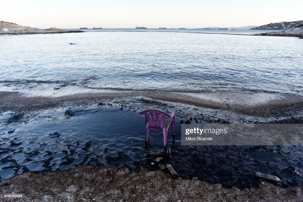 A plastic chair stands on a polluted beach on the coast of Salamis Island on September 13, 2017 in Salamis, Greece. The small tanker 'Agia Zoni II' sank on September 10, whilst anchored off the coast of Salamis, near Greece's main port of Piraeus. It was carrying a cargo of 2,200 tons of fuel oil and 370 tons of marine gas oil. Salamis Island has suffered heavy pollution as a result in what has been called a 'major environmental disaster' by officials.