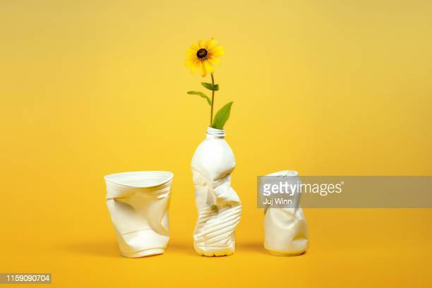 plastic containers repurposed as vases - recycling stock pictures, royalty-free photos & images