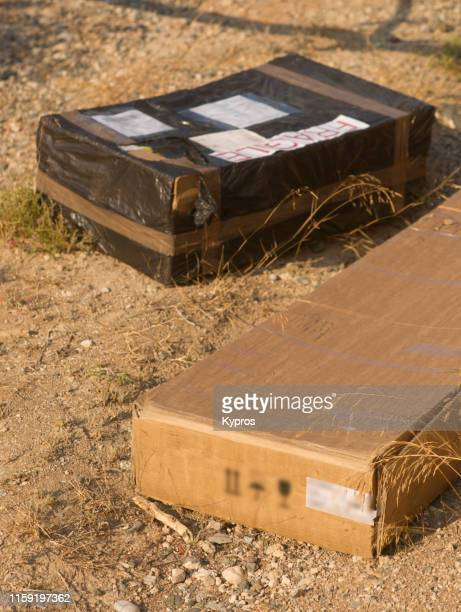 plastic covered cardboard boy with fragile sticker - mail order parcel - fragile sticker stock pictures, royalty-free photos & images