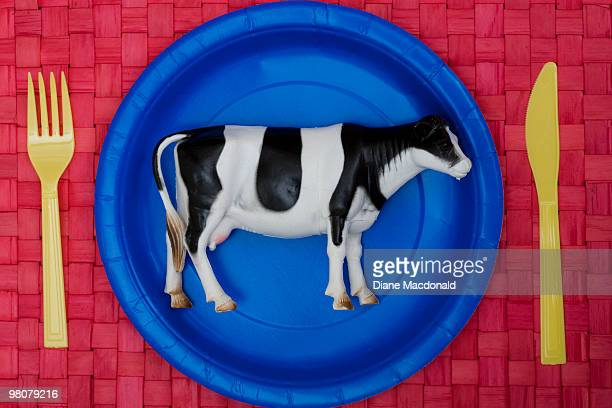 a plastic cow on a plate - plastic plate stock photos and pictures