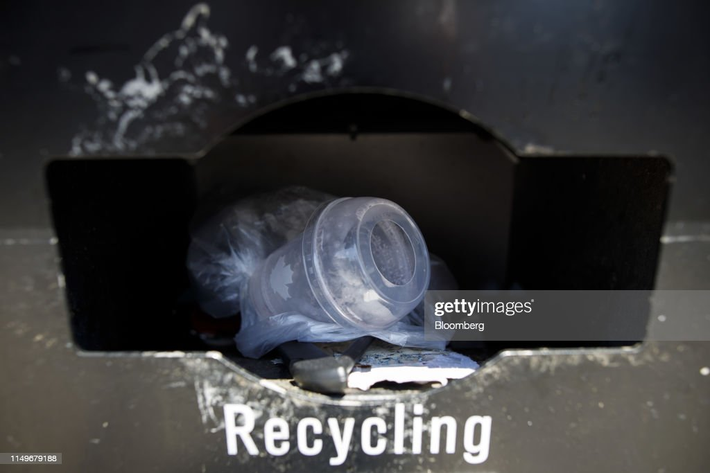 A plastic cup sits in a recycling receptacle in Toronto, Ontario