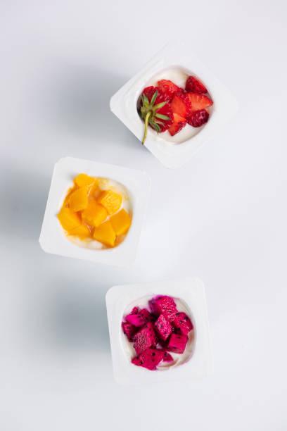 Plastic cups with yogurt, Healthy food of fruits yogurt.