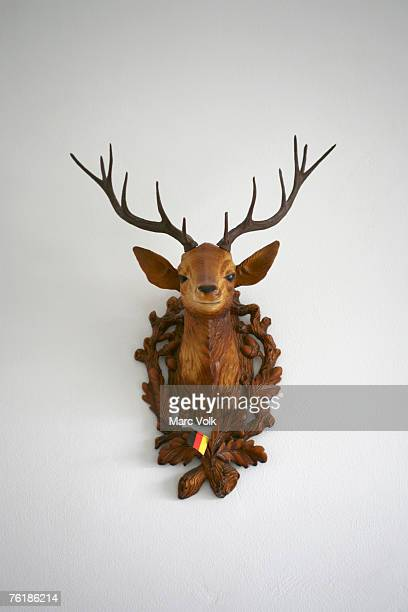 A plastic deer head on a wall