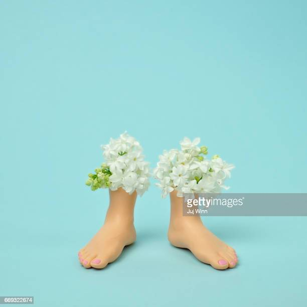 Plastic feet filled with flowers