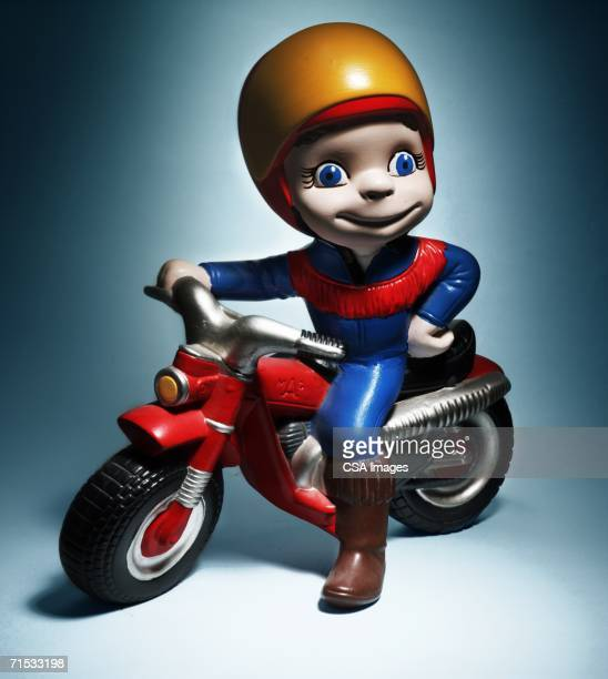 plastic figurine of a motorcycle rider - bobble head doll stock photos and pictures