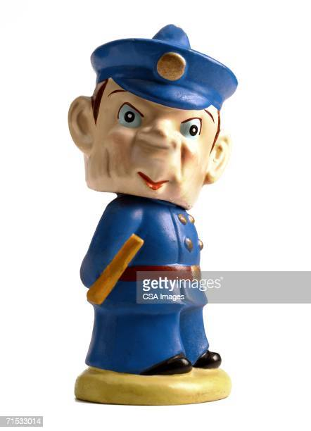 plastic figurine of a policeman - bobble head doll stock photos and pictures