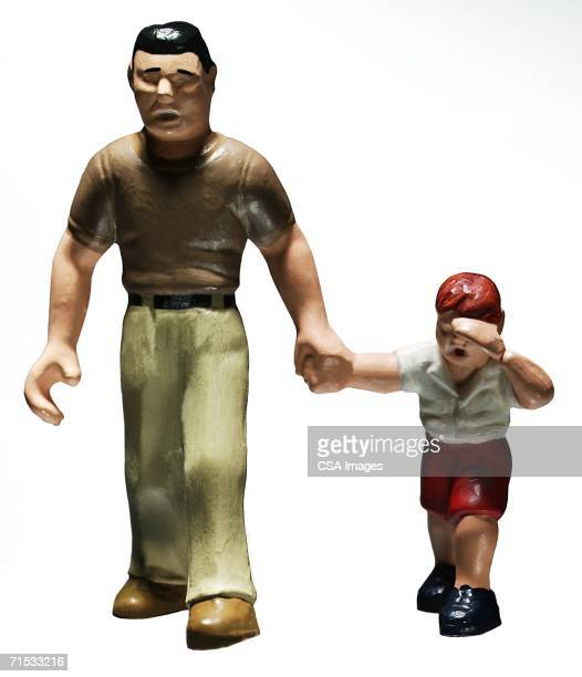 Plastic Figurines of a Man and Boy