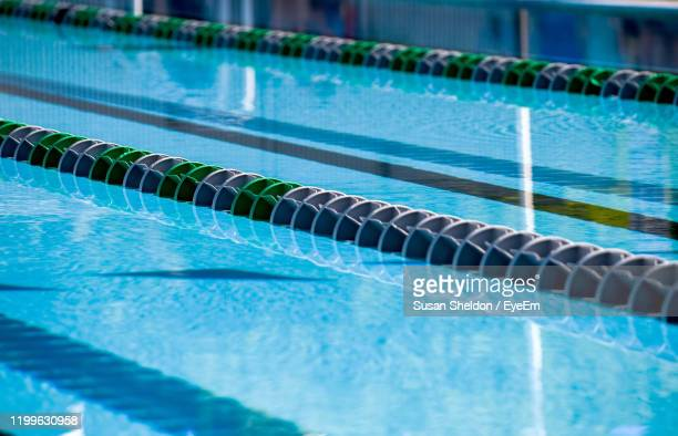 plastic floats create a swim lane in this outdoor pool, all set up for a swim competition - スポーツ用語 ラップ ストックフォトと画像