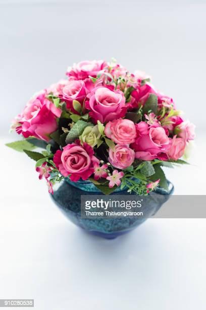 plastic floral bouquet of different flowers - purple roses bouquet ストックフォトと画像