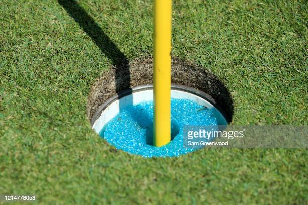 Plastic foam is seen to raise a hole at Windsor Parke Golf Club as a part of the 'No Touch' policy amid the Coronavirus outbreak on March 25 2020 in...