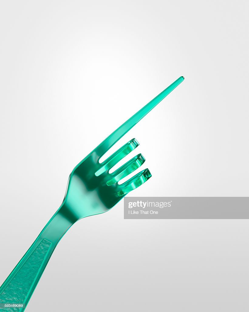 Plastic fork bent to look like a pointing hand : Stock Photo