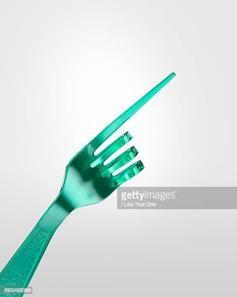 plastic fork bent to look like a pointing hand - atomic imagery stock pictures, royalty-free photos & images