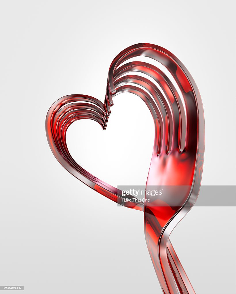 Plastic forks bent into a heart shape : Stock Photo