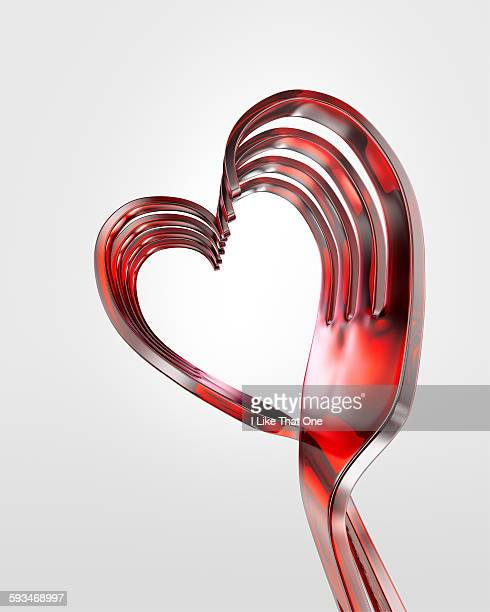 Plastic forks bent into a heart shape
