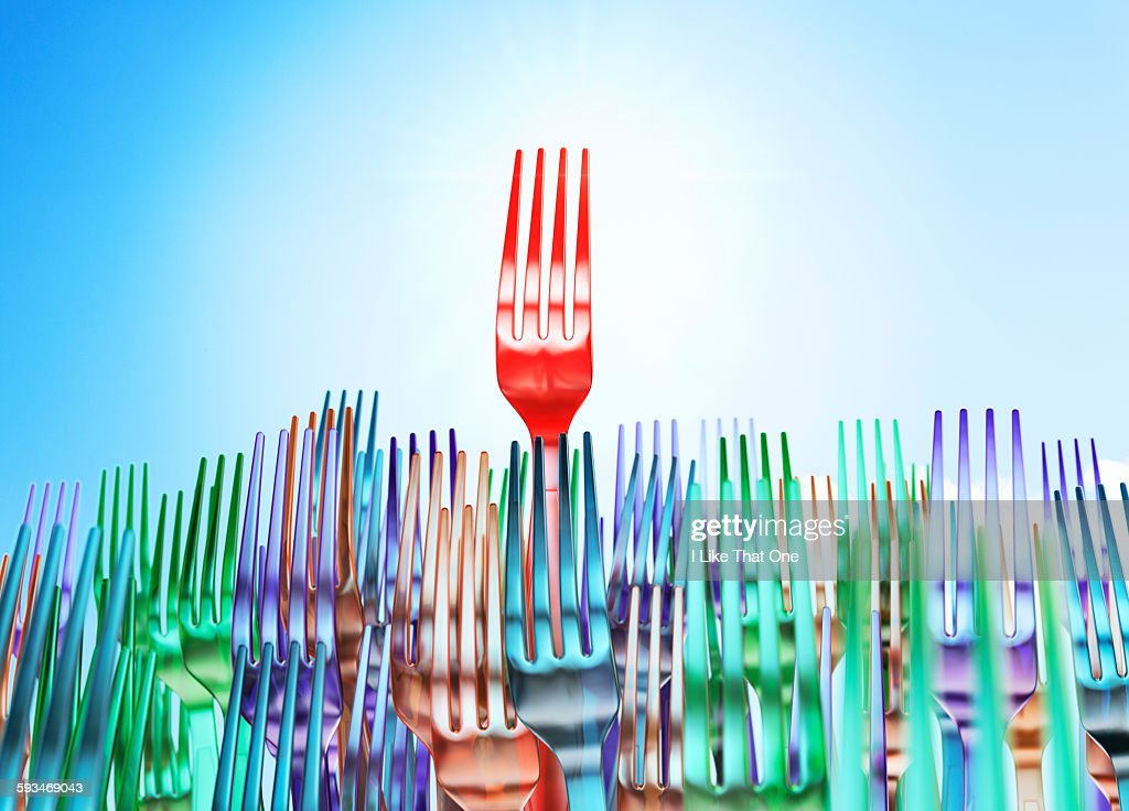 Plastic forks forming a crowd scene : Stock Photo