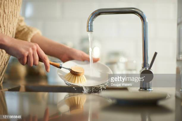 plastic free washing up in kitchen sink. - dougal waters stock pictures, royalty-free photos & images