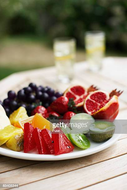plastic fruit on plate - plastic plate stock photos and pictures