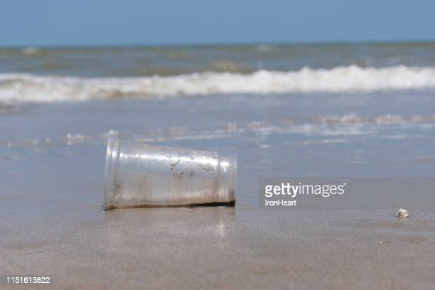 plastic garbage bad environment at sea and beach. - water pollution stock pictures, royalty-free photos & images