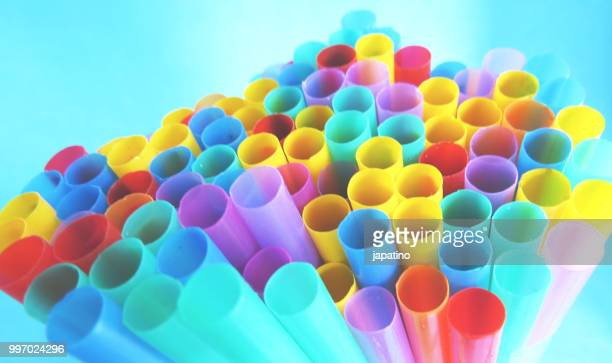 plastic garbage. drinking straw - disposable stock photos and pictures