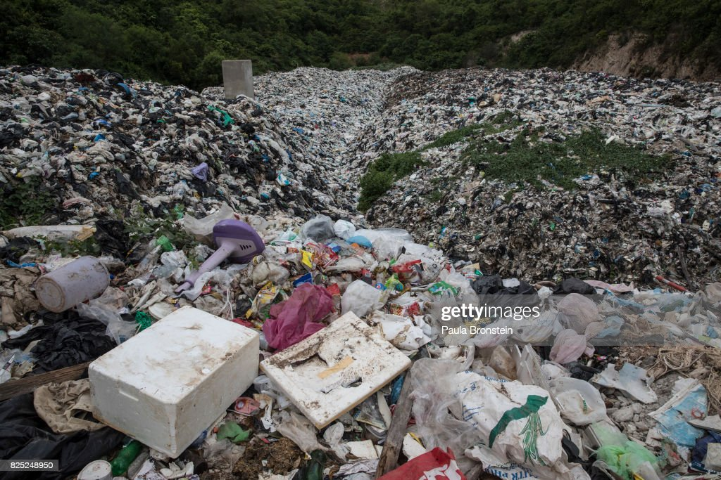 Plastic garbage is piled up at a landfill on the island of Koh Larn on July 30, 2017 in Pattaya,Thailand. Koh Larn which lies just off the coast of Pattaya attracts thousands of tourists a day which stresses the island's infrastructure, along with its waste-management system. A University study is currently underway that looks at the relationship between the number of tourists and the impact on the environment in order to determine the ideal number of daily visitors. Most plastic items, like packaging, tend to be used for very short periods before being discarded. According to a recent published study, Thailand along with China, Indonesia, the Philippines and Vietnam are on the list of the world's top-five plastic polluters. Cleaning up plastic pollution in Thailand is a challenge due to cultural, infrastructure and environmental obstacles.