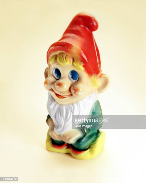 plastic garden gnome - troll stock photos and pictures