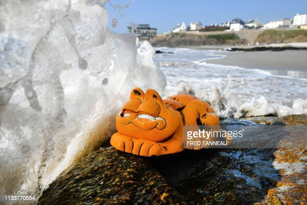 TOPSHOT A plastic 'Garfield' phone is displayed on the beach on March 30 2019 in Le Conquet western France For more than 30 years plastic phones in...