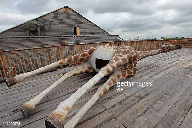 A plastic giraffe and elepahnt are seen on the 150 metrelong Noah's ark created by Dutch Johan Huibers at an old abandoned quay on the Merwede River...