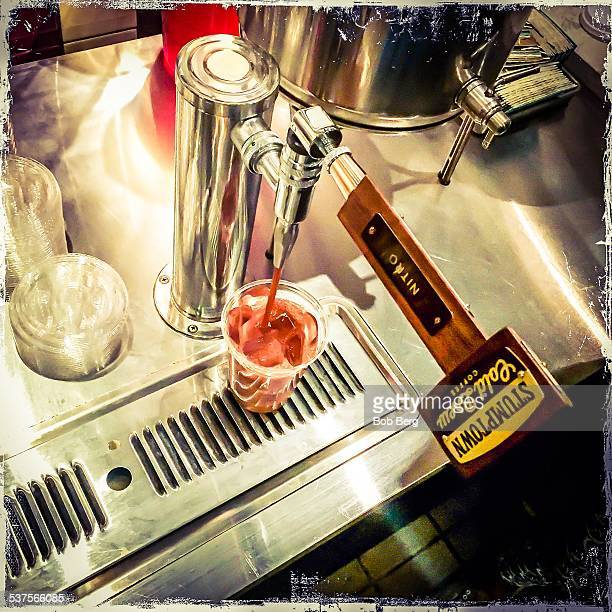 West Hollywood Ca February 6 2015 A plastic glass is filled with nitro coffee by tap