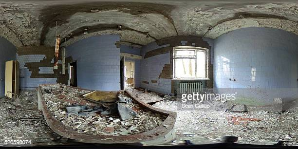 Plastic gloves lie on an examining table in a former morgue on April 9 2016 in Pripyat Ukraine Pripyat built in the 1970s as a model Soviet city to...