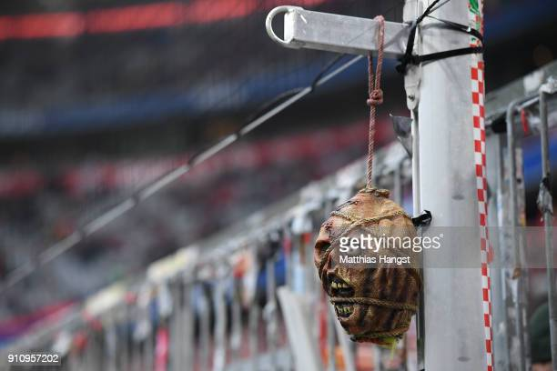 A plastic head on a string is hanging on a post near the stand of the Bayern Muenchen supporters before the Bundesliga match between FC Bayern...