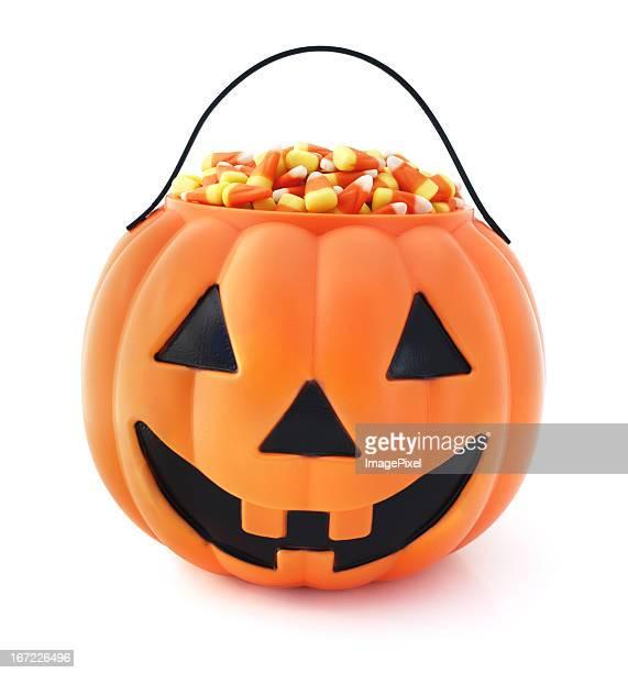 Plastic jack o lantern full of Halloween candy